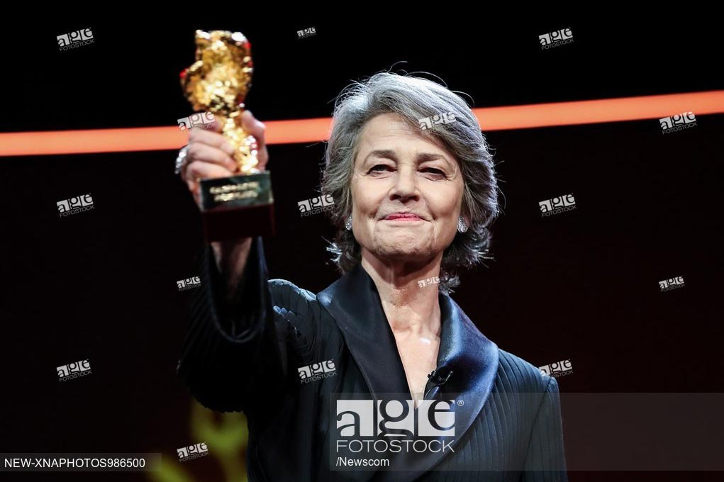 British actress Charlotte Rampling, winner of the Honorary Golden Bear prize for lifetime achievement, holds the trophy at the award ceremony during the 69th Berlin International Film Festival in Berlin. February 14, 2019