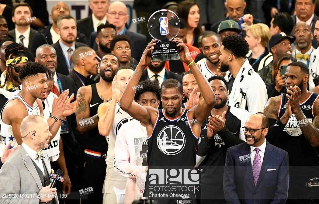 Team LeBron's Kevin Durant, of the Golden State Warriors, raises the MVP trophy after the 2019 NBA All-Star 2019 game at Spectrum Center in Charlotte, N.C . on Sunday, February 17, 2019.