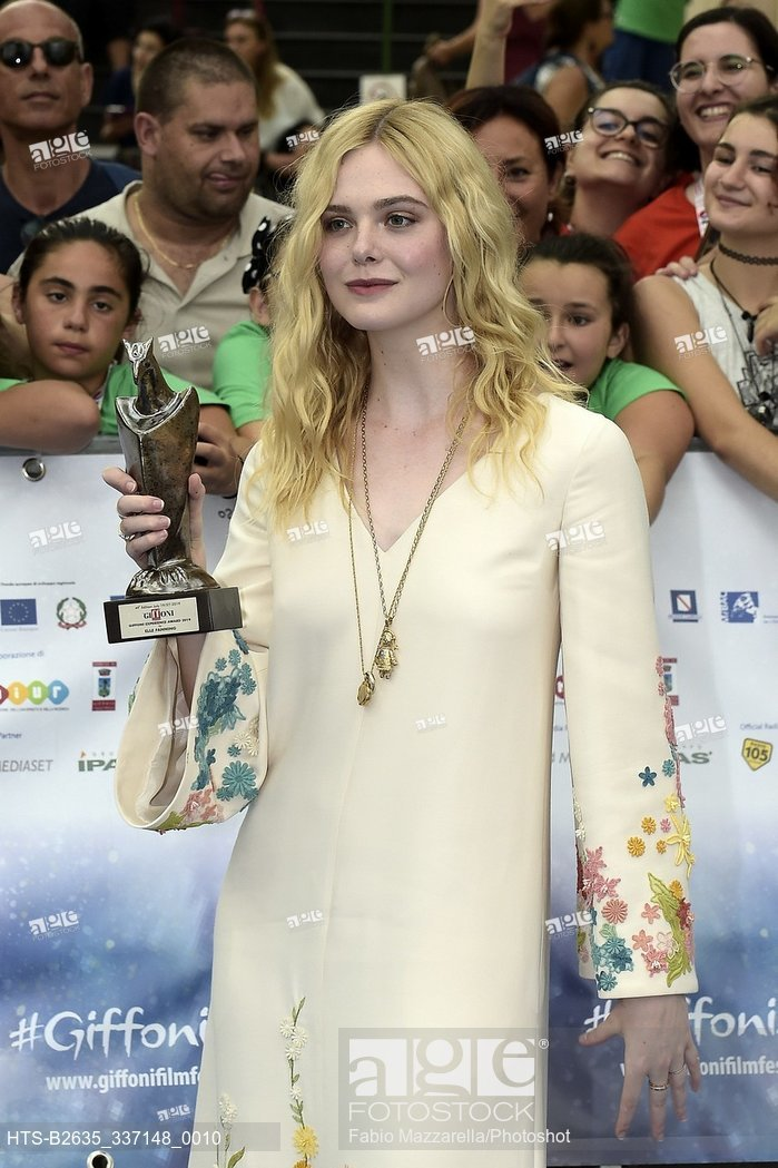 Elle Fanning receives the Giffoni Experience Award at the Giffoni Film Festival