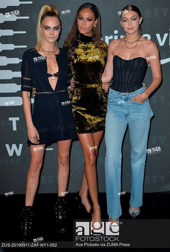 Cara Delevingne, Joan Smalls and Gigi Hadid arriving at the Savage X Fenty event during New York Fashion Week