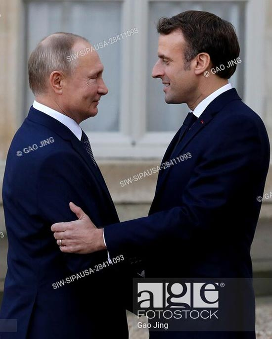 French President Emmanuel Macron welcomes Russian President Vladimir Putin to attend a summit on Ukraine in Paris, France