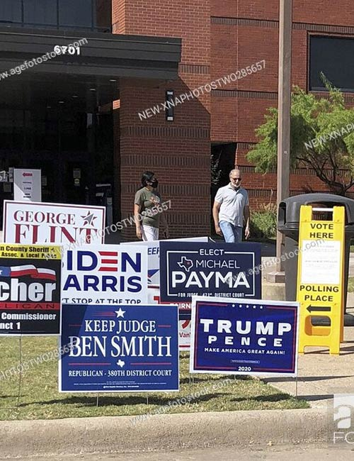 People walk out of a polling station in Plano, Texas. Early voting in the U.S. state of Texas started on Tuesday