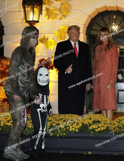 U.S. President Donald Trump and First Lady Melania Trump greet children dressed up in costumes during a Halloween event on the South Lawn of the White House in Washington, D.C.