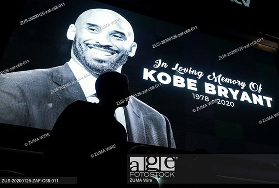 Fans gather at a memorial for former NBA player Kobe Bryant at L.A. Live, outside of the Staples Center in Los Angeles, California