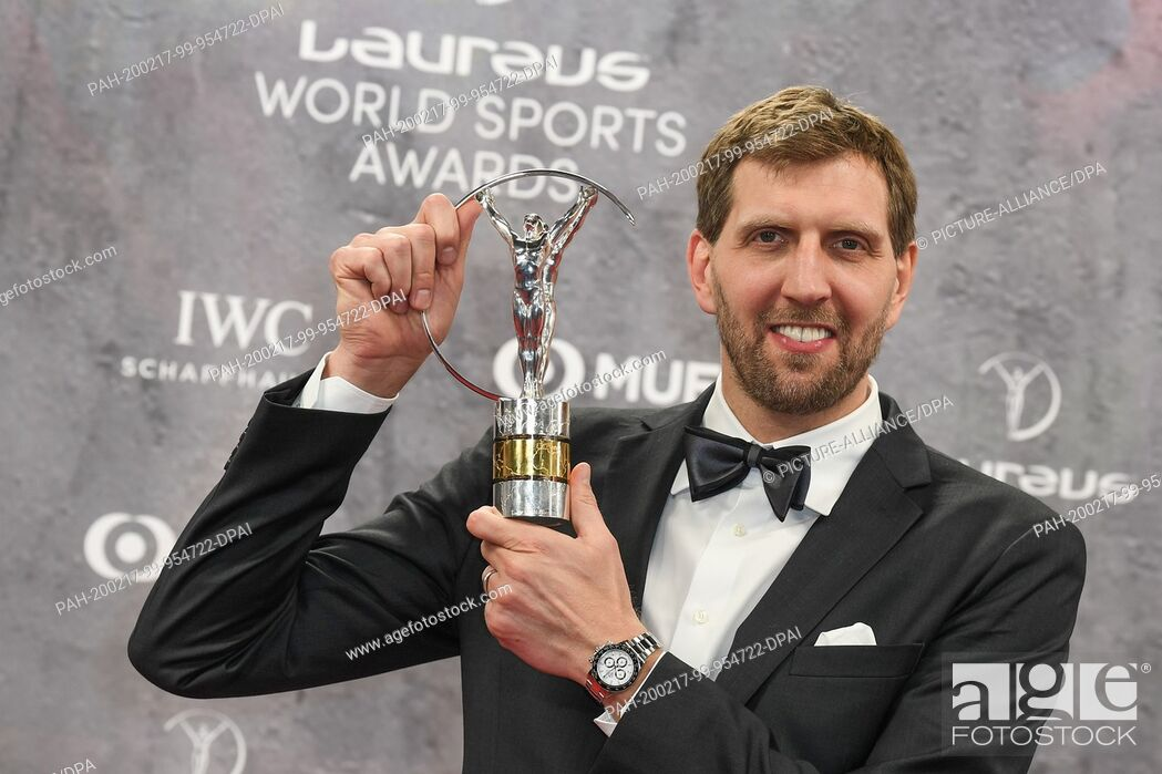 Dirk Nowitzki holds the trophy in the Lifetime Achievement category at the Laureus Sport Awards ceremony