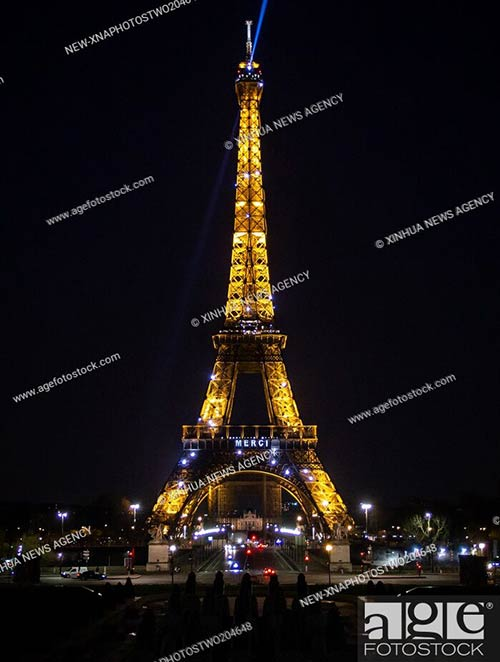 The word Merci is shown on the illuminated Eiffel Tower in Paris, to pay tribute to those who have devoted themselves to the fight against COVID-19