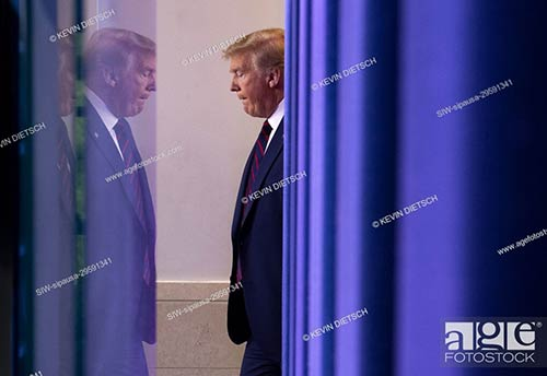 US President Donald Trump arrives for a Coronavirus briefing at the White House