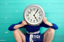 Stock photo of a woman with a clock