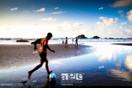boy playing soccer in the beach, San Roque beach, Tenerife, Canary Islands, Spain