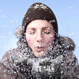 Young woman blowing snow, close_up