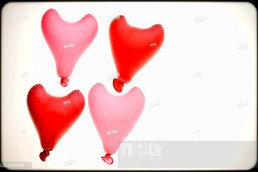 Group of four heart red shaped balloons.