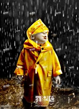 Petrichor - Stock image of a children under the rain