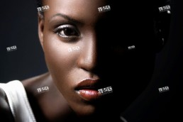 Young black african woman artistic closeup face beauty portrait with dramatic lighting