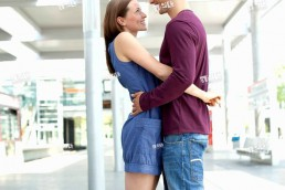 Germany, North_Rhine_Westphalia, Duesseldorf, Young woman embracing in train station