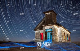 Abandoned Taiban Presbyterian Church in New Mexico at night with star trails.