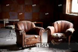 Indoor view. Two old sofas in abandoned room