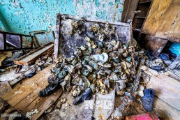 Old gas masks in abandoned Jupiter Factory in Pripyat ghost town of Chernobyl Nuclear Power Plant Zone of Alienation in Ukraine.