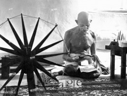 Gandhi reading newspaper cuttings. 1946
