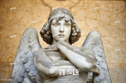 Picture and image of the stone sculpture of an enigmatic angels face in a realistic style. One of the best know csulptures of Staglieno. The Oneto family tomb sculpted by G Monteverde . Section D no 13, the monumental tombs of the Staglieno Monumental Cemetery, Genoa, Italy.