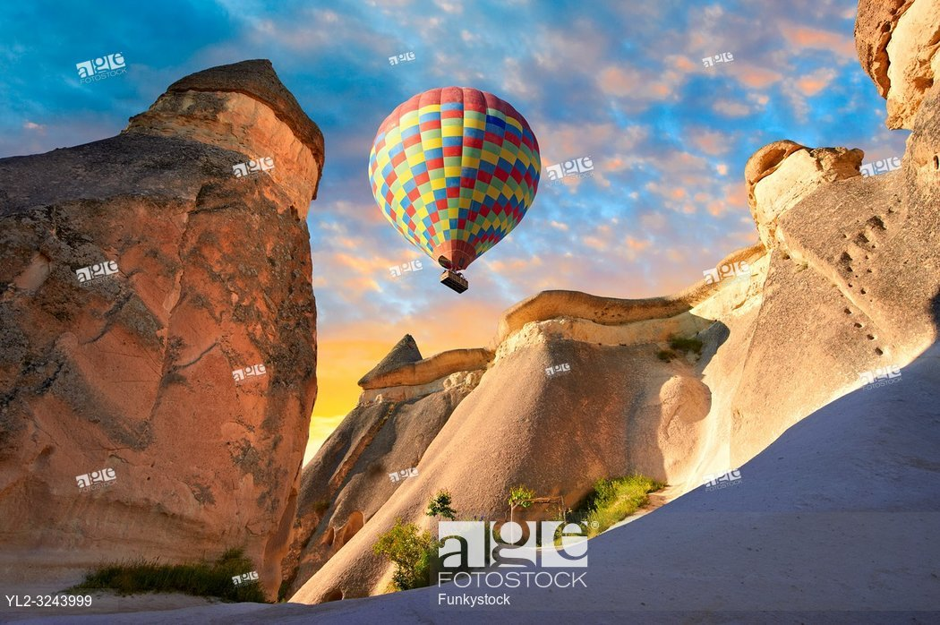 "Pictures & images of hot air balloons over the fairy chimney rock formations and rock pillars of ""Pasaba Valley"" near Goreme, Cappadocia, Nevsehir, Turkey."