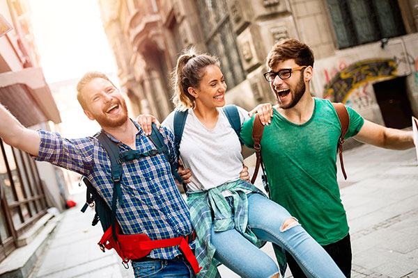 Young travelling people having fun and sightseeing in city