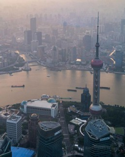 The Oriental Pearl TV Tower and smog along the Huangpu River, Shanghai, China