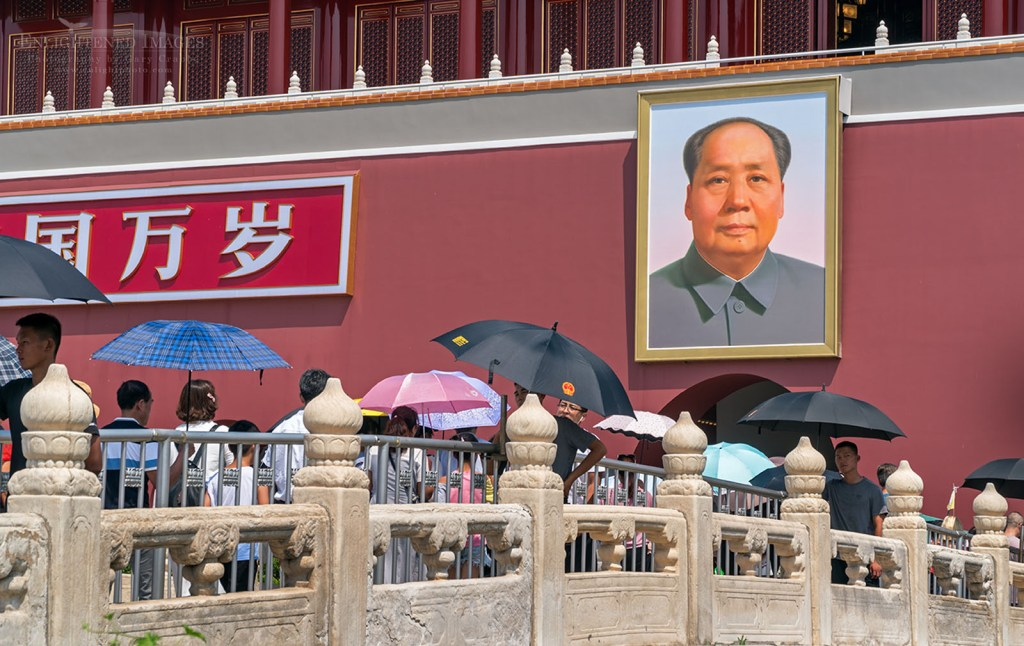 Portrait of Chairman Mao Zedong hangs on the Tiananmen Gate, or Gate of Heavenly Peace, at the entrance to the Imperial Forbidden City, Dongcheng, Beijing, China