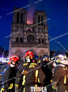 Firefighters at the doors of Notre Dame de Paris Cathedral during the fire